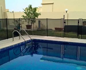 Pool safety fence at Golf Villas, Abu Dhabi.