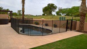 Pool safety fence, at Flame Tree Ridge, Jumeirah Golf Estates, Dubai.