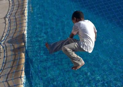 Pool safety net at Golf Villas, Abu Dhabi.